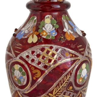 Bohemian gilt, enamelled and cut red overlay glass decanter