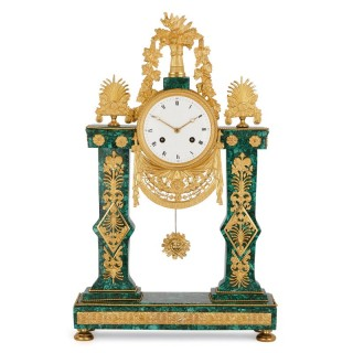Empire period gilt bronze mounted malachite mantel clock