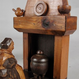 A pair of very rare and amusing very decorative wooden black forest bookends.
