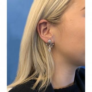 Vintage diamond earrings, circa 1950.
