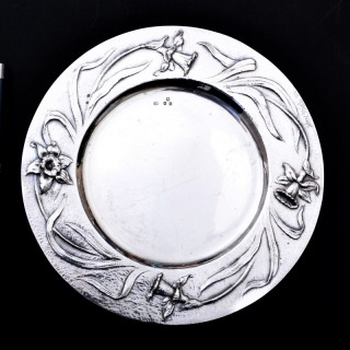 A remarkable set of twelve Gilbert Marks silver plates with flower borders
