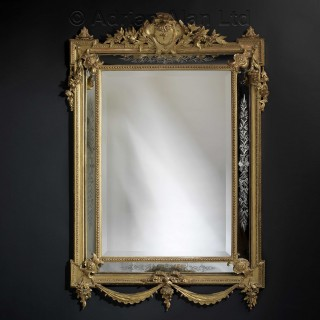 A Giltwood Marginal Mirror With Etched Side Plates