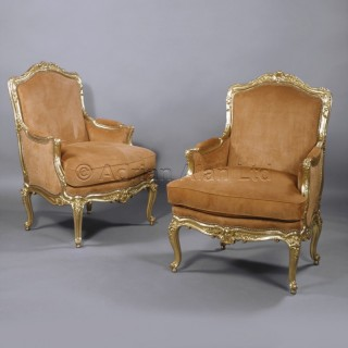 An Important Pair of Louis XV Style Giltwood Bergères