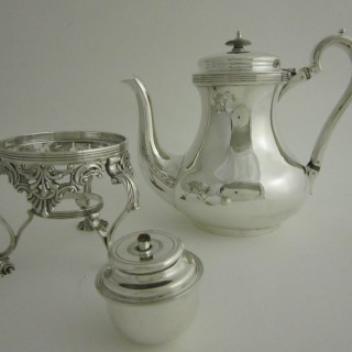 Antique Irish Sterling silver teapot on stand
