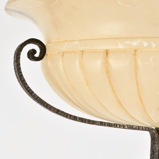 An Art Deco alabaster and wrought iron floor lamp