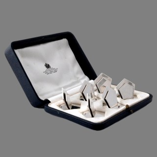 A set of six modernist Edwardian Asprey silver card holders