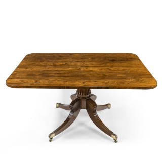 A Regency rectangular rosewood tilt-top table attributed to Gillows