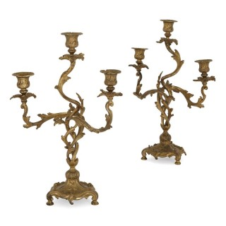 Two antique Rococo style gilt bronze candelabra