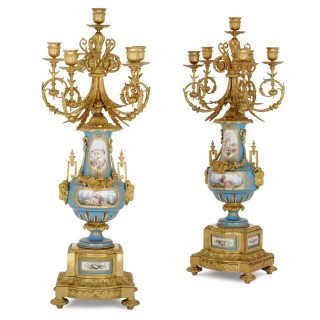 Two antique Sèvres style porcelain and gilt bronze candelabra