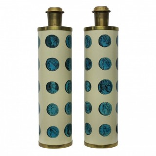 A PAIR OF SIGNED FORNASETTI LAMPS