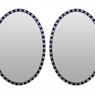 A PAIR OF GEORGIAN STYLE IRISH STUDDED MIRRORS