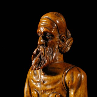 A Rare Very Fine Carved Boxwood Sculpture Of A European Pirate.