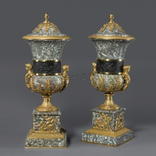 A Pair of Bronze Mounted Marble Vases and Covers
