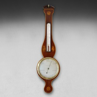 George III Period Mahogany and Shell Inlaid eight inch dial wheel barometer