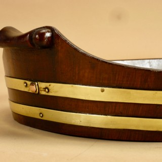 A very decorative and useful original oval mahogany coopered tray.