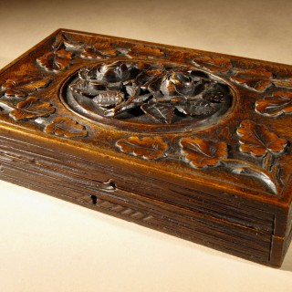 A Fine Carved Black Forest Game Box Set Circa:1900.