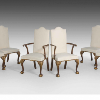 SET OF EIGHT WALNUT AND PARCEL GILT CHAIRS