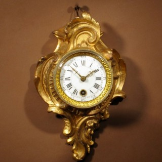 A Delightful Very Small Gilded French Cartel D'alcove Clock In the Louis Quinze Style, Circa 1900.