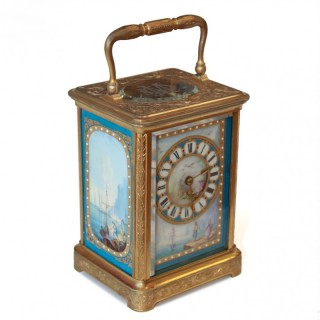 Porcelain carriage clock in an engraved case