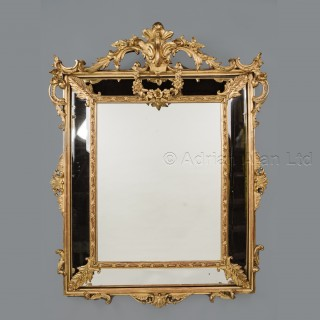 A Louis XV Style Carved Giltwood Marginal Mirror