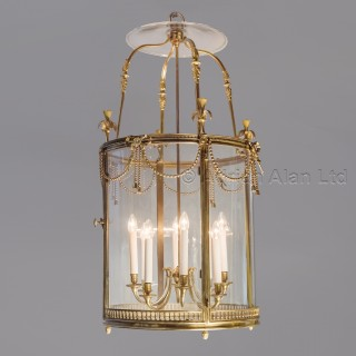 A Large Louis XVI Style Gilt-Bronze Cylindrical Eight-Light Lantern