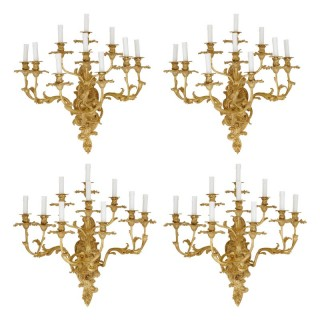 Four antique Rococo style gilt bronze wall sconces