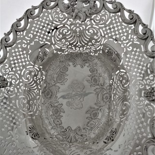 Magnificent double armorial George II silver basket London 1753 John Jacobs 59 ounces.