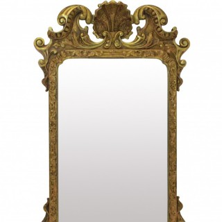 A GEORGE III GILT WOOD MIRROR