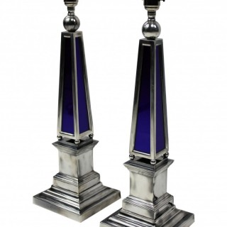 A PAIR OF SILVER & BLUE GLASS OBELISK LAMPS