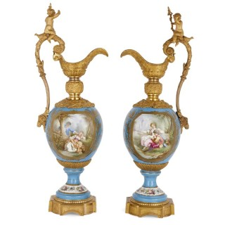 Two large Rococo style porcelain and gilt bronze jugs