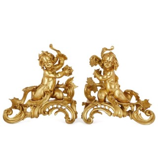 Two Rococo style gilt bronze chenets