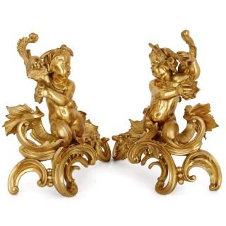 Two Rococo style gilt bronze chenets