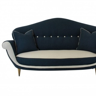 A LARGE ITALIAN SOFA OF UNUSUAL DESIGN & SHAPE