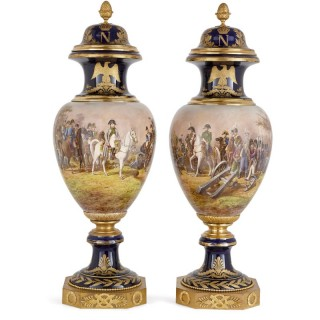 Pair of large gilt bronze and porcelain vases with Napoleonic battle scenes