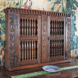 Charles I oak carved mural livery cupboard