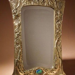 A Decorative and Stylish Art Nouveau Embossed brass Mirror