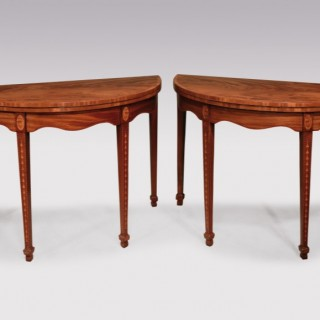An attractive pair of late 18th Century Sheraton period figured & faded mahogany Card Tables