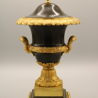 A Pair of Early 19th Century Bronze & Ormolu Urns and Covers
