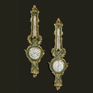 A Louis XV Style Green Stained Horn Clock and Barometer Set