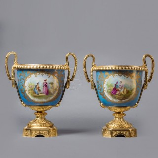 A Pair of Sèvres Style Blue Celeste Ground Porcelain Jardinieres