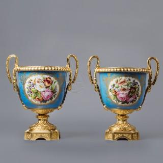A Pair of Sèvres Style Blue Celeste Ground Porcelain Jardinieres