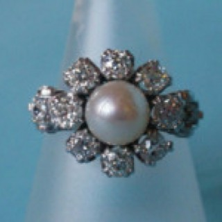 Pearl and Diamond Cluster Ring set in 14 carat white gold.