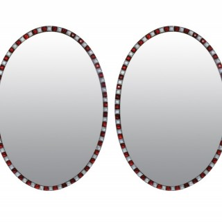 A PAIR OF RUBY GLASS STUDDED IRISH MIRRORS
