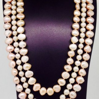 Three Row Pink and White Pearl Necklace.