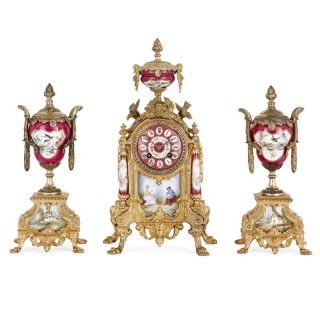 Antique porcelain mounted gilt metal clock set