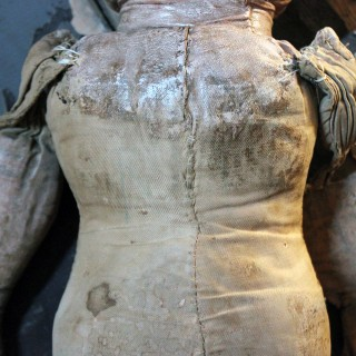 A Large Primitive Oil-Cloth Hand-Stitched Doll c.1900