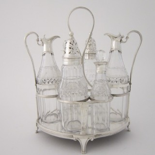 Antique George III Sterling silver cruet stand and bottles