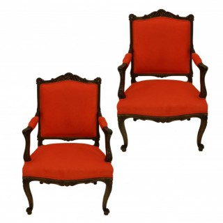 A PAIR OF FRENCH LOUIS XV WALNUT ARMCHAIRS IN ORANGE CORDUROY