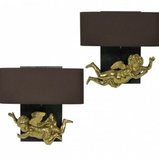 A PAIR OF ADORABLE GILT BRASS CHERUB WALL SCONCES