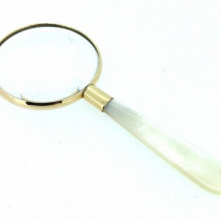 Gold Framed Magnifying Glass.